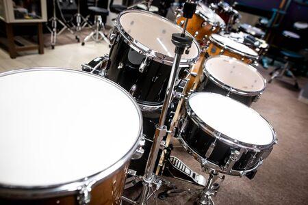 Professional drum kit in instrument shop, instrumental concept