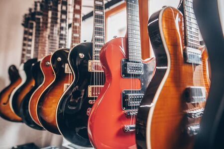 Close up of professional electric guitar in a row in instrument shop, instrumental concept Zdjęcie Seryjne