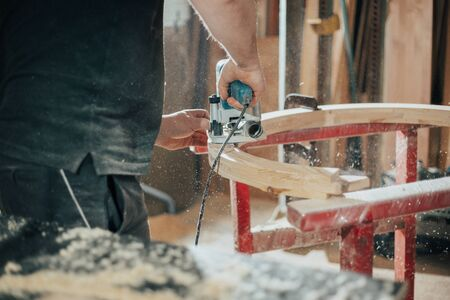 Joinery, woodworking and furniture making, professional carpenter cutting wood in carpentry shop, industrial concept Stockfoto