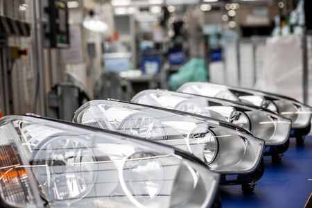 Close up of car headlamps, headlights in a row ready for assembly to the car
