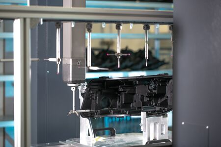 Close up of a 3D dimension measurement plastic parts by CMM, 3D automatic measuring system