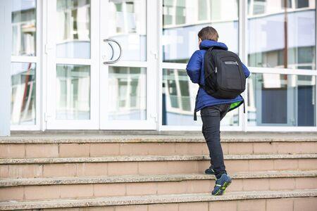 Schoolboy going to the elementary school, education concept 版權商用圖片