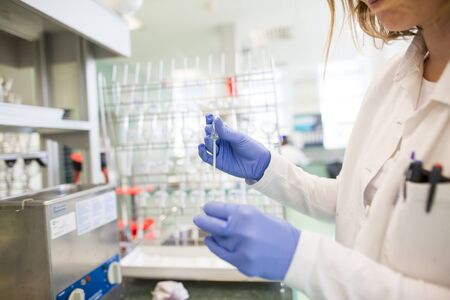 Flasks with liquids in a lab, pharmaceutical industry factory and production laboratory
