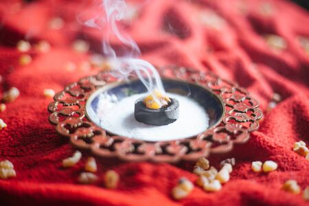 Frankincense burning on a hot coal. aromatic resin, used for religious rites, incense and perfumes, incense smoke