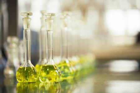 Flasks with liquids in a lab, pharmaceutical industry factory and production laboratory, chemistry concept