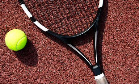 Tennis racket and ball on the professional tennis court, sport concept Banco de Imagens