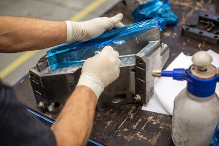 Process of maintenance a parts of a huge mold for plastic moldings, industrial concept