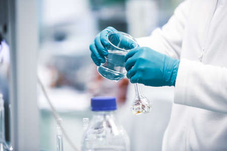 Pharmacist developing the new a drugs and pills in the pharmacy laboratory