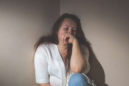 Young woman suffering from a severe depression and anxiety, psychiatric problem after covid-19