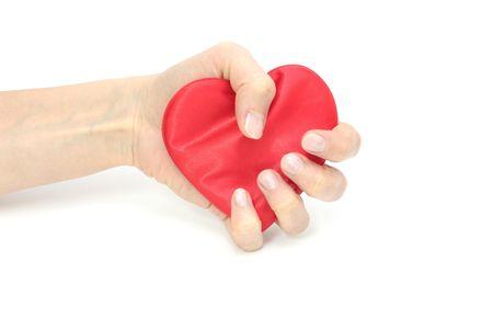 zdradę: Serce skompresowane na biaÅ'ym tle izolowanych. Zdjęcie Seryjne