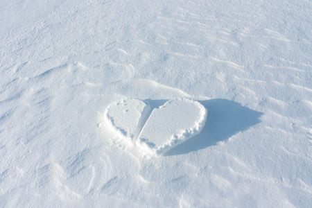 Frozen heart lies on the clean snow. Stock Photo - 6517146