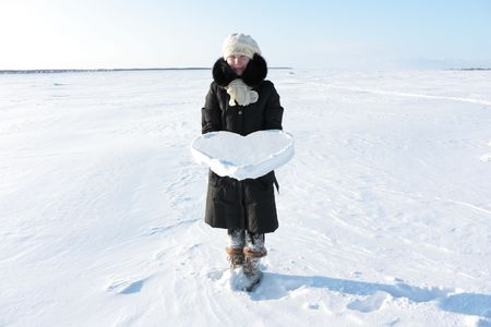 A girl holds a heart of ice. Stock Photo - 6509900