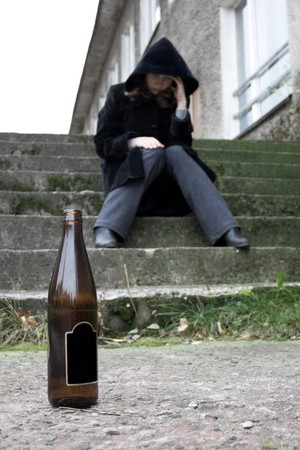 Drunk woman with a bottle. Stock Photo - 8050812