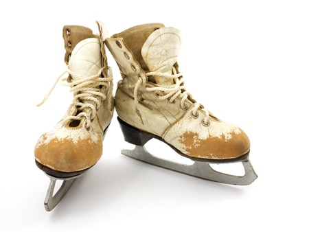 Old skates on a white background.