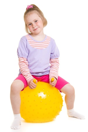 Girl with a ball on a white background. photo