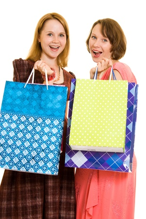 Girls with shopping on white background. photo