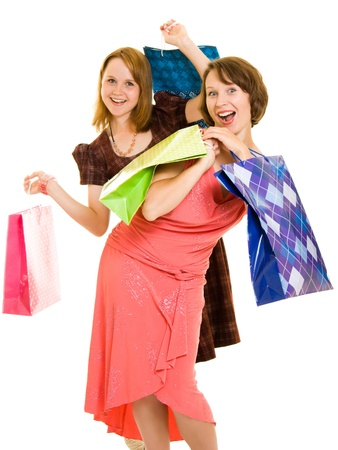 shoppingbags: Girls with shopping on white background. Stock Photo