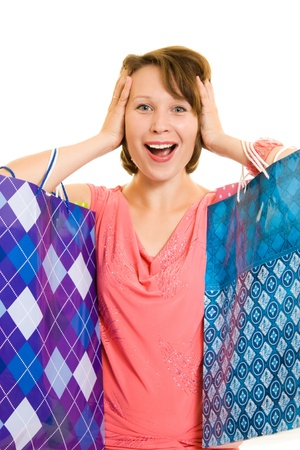 Girl with shopping on white background. photo