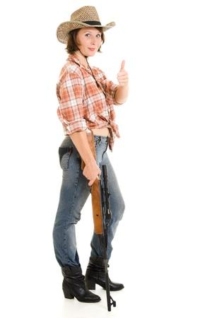 Cowboy woman with a gun on a white background. photo