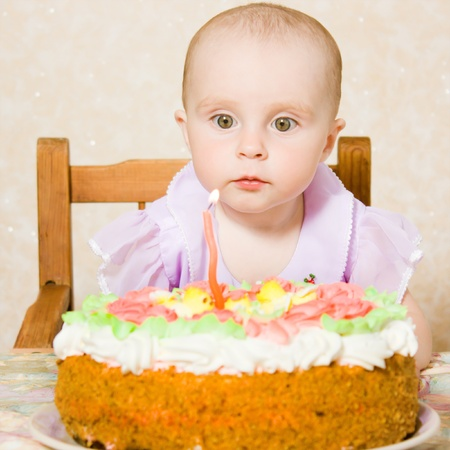 Baby with the birthday cake. photo