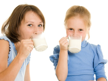 Mom and daughter drink milk. photo