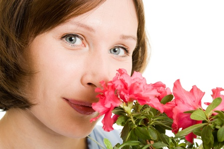 Girl smelling a flower on a white background. photo