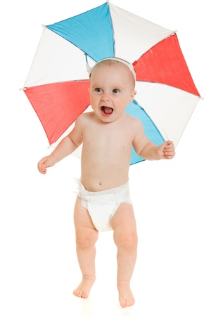 The kid with an umbrella on his head. Stock Photo