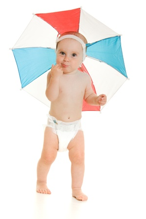 The kid with an umbrella on his head. Stock Photo - 10551349