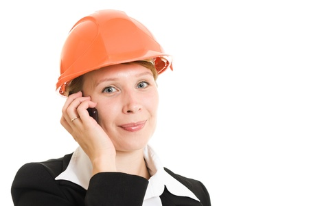 Businesswoman in a helmet on a white background. photo