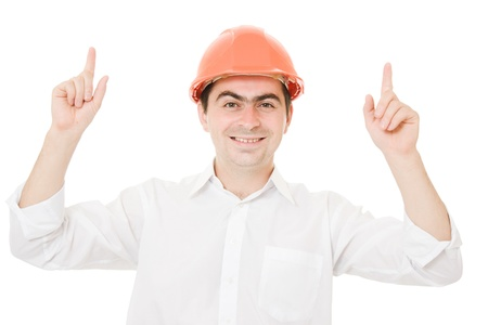 Businessman in helmet pointing up. Stock Photo - 10550574