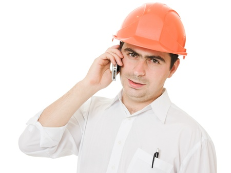 Businessman in helmet on the phone. photo