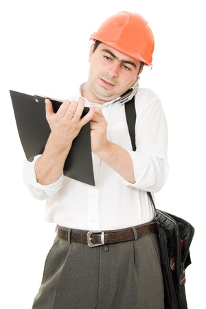 Busy businessman in his helmet on a white background. photo