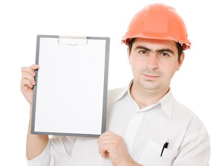 Businessman in helmet holding a tablet. photo