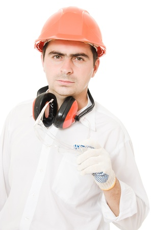 Businessman in a helmet on a white background. photo
