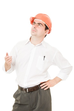 Businessman in a helmet looking up. photo