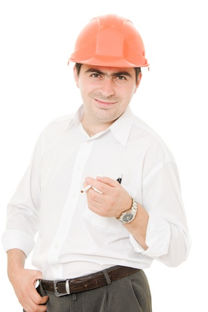 Businessman in a helmet with a cigarette. photo