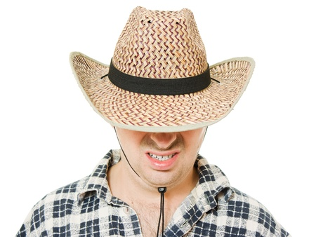 pulled over: Cowboy hat pulled down over his eyes.