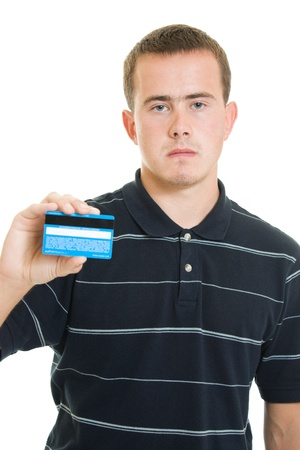 Man with a debit card on a white background. photo