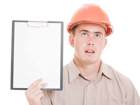 huh: Businessman in helmet holding a tablet. Stock Photo