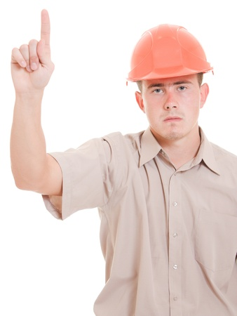 Businessman in helmet pointing up. photo
