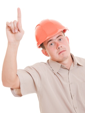 Businessman in helmet pointing up. Stock Photo - 11182547