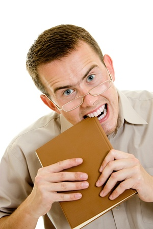 The man in glasses eats book. Stock Photo - 11182220