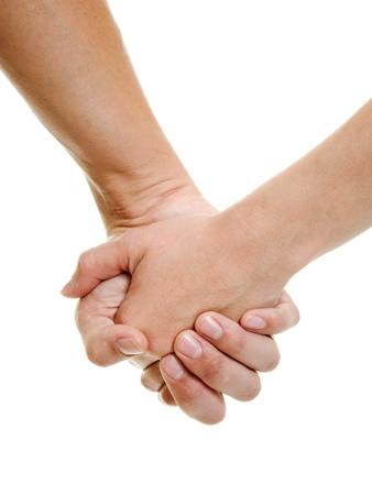 manos juntas: Manos de los amantes sobre un fondo blanco.
