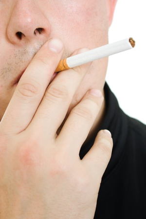 A man with a cigarette in his mouth. photo