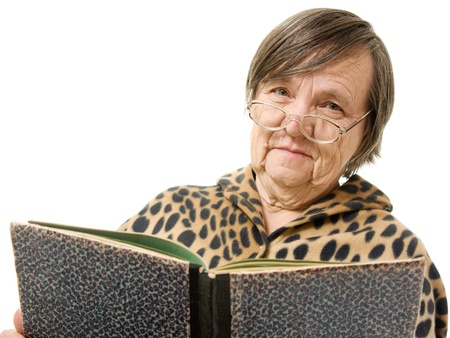 The old woman is reading a book on a white background photo