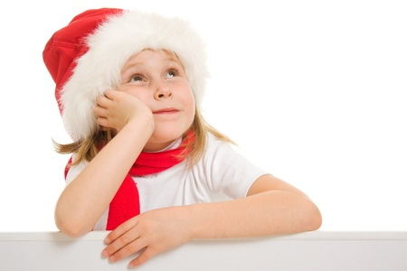 Happy Christmas child with the board looking up on a white background. Stock Photo - 11181938