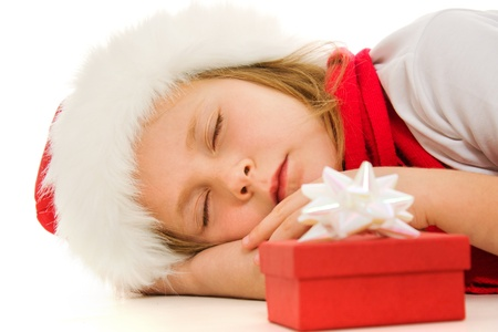 Christmas child is sleeping on the floor. photo