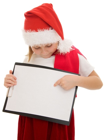 Happy Christmas child points his finger at the white board. Stock Photo - 11181873