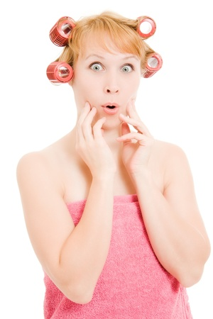 crazy woman: Woman in curlers moans on a white background.