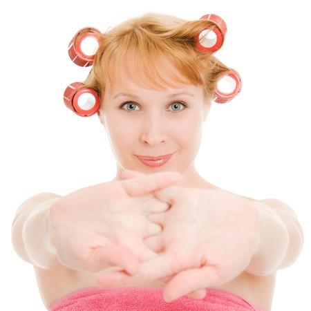 Woman in curlers stretched on a white background. photo